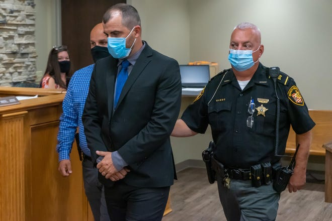 Former Frazeysburg Elementary School principal Cory Marling is escorted out of the courtroom after being sentenced to 340 days in jail and three years of probation for attempted child endangering.