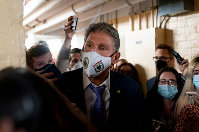 Sen. Joe Manchin, D-W.Va., speaks to reporters as he leaves a private meeting with Sen. Kyrsten Sinema, D-Ariz., White House domestic policy adviser Susan Rice, Director of the National Economic Council Brian Deese, and other White House officials on Capitol Hill in Washington on Sept. 30, 2021.