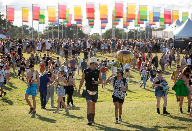Fans walk through the grounds Friday, Oct. 1, at the Austin City Limits Music Festival in Zilker Park. Friday's rain delay is not expected to be repeated for the rest of the weekend. The forecast is mostly dry.