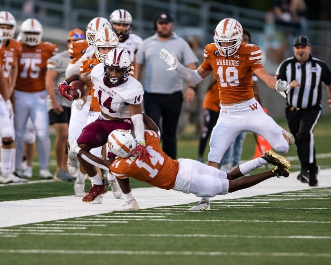 Round Rock's Trayvian McCoy-Gay of Round Rock is driven out of bounds by Westwood's Darion Barnes in Friday's District 25-6A contest at Kelly Reeves Athletic Complex. Round Rock won the game 35-0.