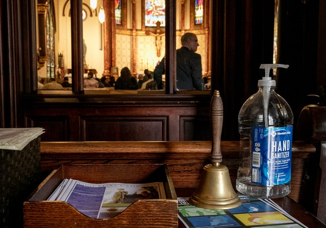 St. Mary's Cathedral provided hand sanitizer and safety information about COVID-19 as parishioners entered in mid-March 2020. Austin and Travis County limited church occupancy during the early weeks of the pandemic.