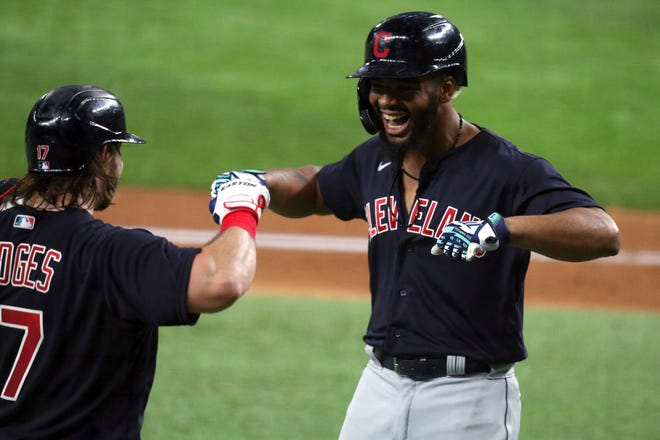 Cleveland's Austin Hedges, left, celebrates a solo home run by Bobby Bradley, right, in the fourth inning against the Texas Rangers during a baseball game Friday, Oct. 1, 2021, in Fort Worth, Texas. (AP Photo/Richard W. Rodriguez)