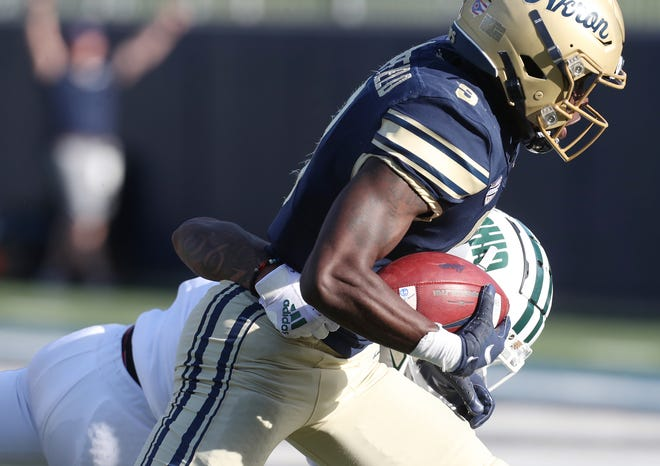University of Akron wide receiver Konata Mumpfield scores on a catch during a 34-17 loss to Ohio University on Saturday at InfoCision Stadium. [Mike Cardew/Beacon Journal]