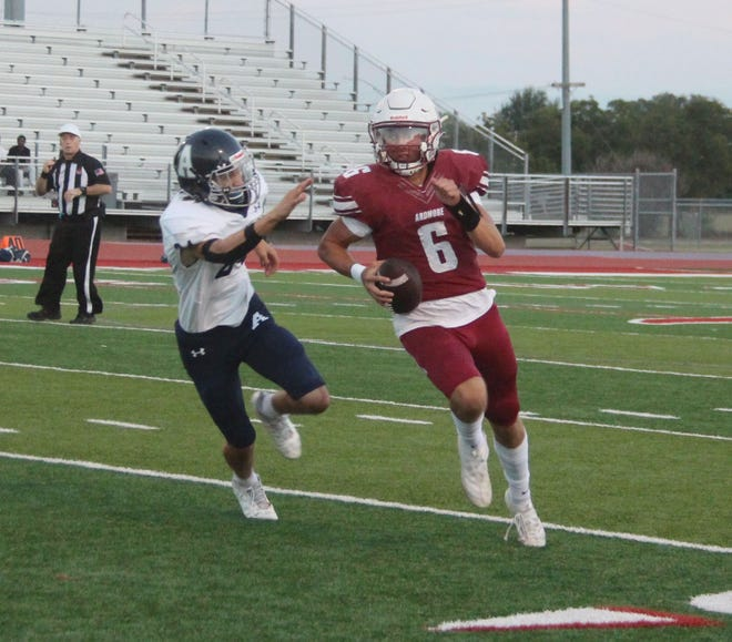 Tigers junior Cal Swanson gets past an Altus defender. The quarterback threw for four touchdowns, while also rushing for a score Friday night in a 61-0 shutout of Altus.