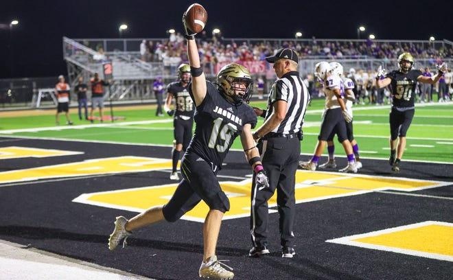Andover Central's Kamden Wilson celebrates a touchdown against Valley Center on Friday, October 1.