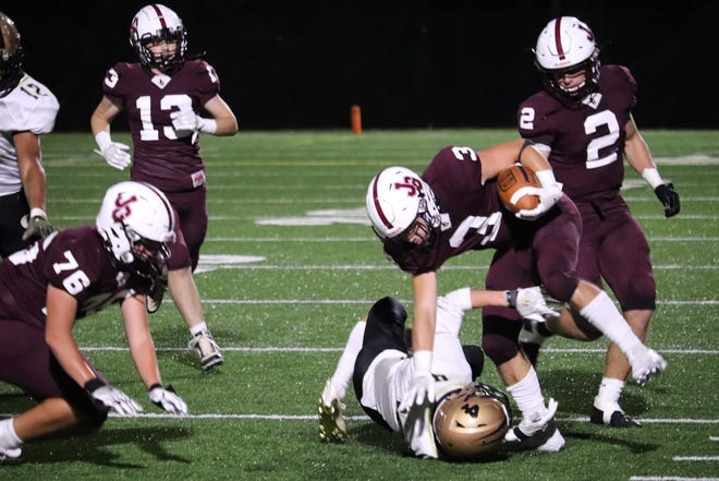 John Glenn's Blade Barclay (3) fights through a River View defender in Friday's 48-14 win.