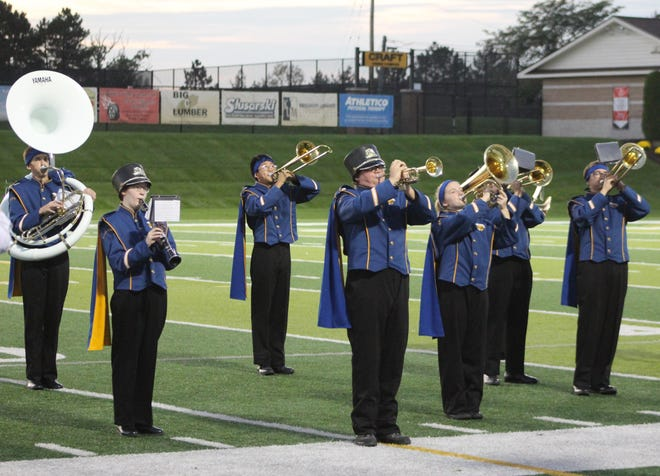 Members of the Madison High School Marching Band perform Oct. 1, 2019, at the Lenawee County Marching Band Festival at Adrian College. This year's festival is Tuesday, Oct. 5, at Siena Heights University's O'Laughlin Stadium.