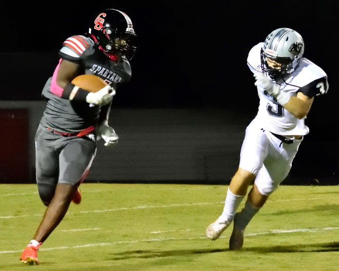 Central Davidson's Cory Casilac eyes Ledford's Evan Campbell as he turns the corner Friday night. [David Yemm for The Dispatch]