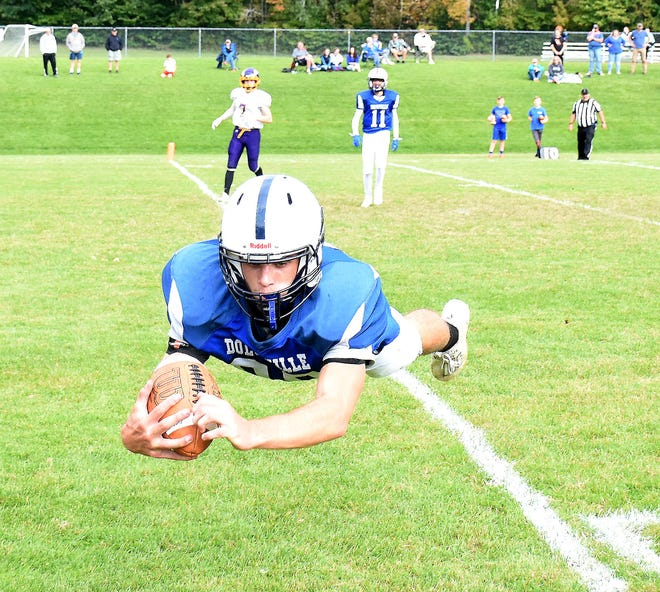 Dolgeville tight end Kamryn Comstock makes a diving catch for his second touchdown against Waterville/Hamilton Saturday.