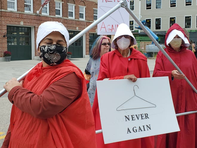 A dystopian future? Women across the country marched Saturday to defend women's reproductive rights. Anna Howard of Portsmouth, Lynn Joslyn of Rye and Judy Stahl of Kittery made their point in a very dramatic way.