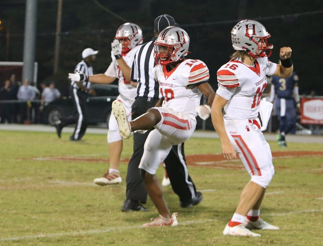 Hendersonville's Elyja Gibbs, left, celebrates his interception along with teammate Gavin Gosnell during Friday's win over Chase at Dietz Field.