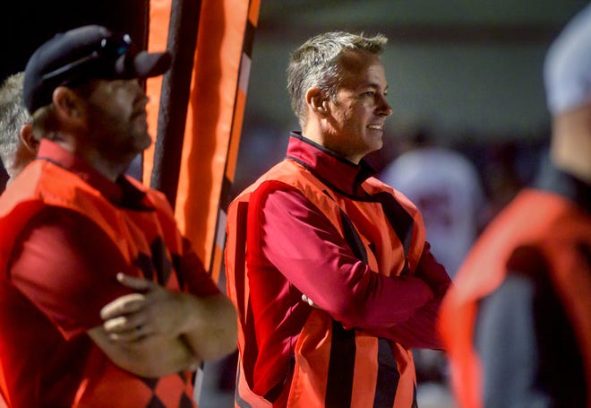 IHSA Executive Director Craig Anderson works as part of the chain gang on the sidelines of the Morton/Metamora football game Friday, Oct. 1, 2021 at Carper Field in Morton.