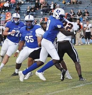 DeRidder defender Bryant Hammond (9) wraps up a ball carrier during a recent Dragon outing. Hammond and the rest of the defense limited Marksville to only one score in a 9-7 DeRidder win.