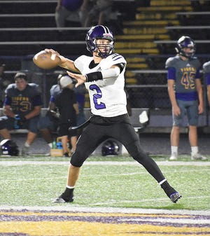 Rosepine junior Jake Smith (2) fires a pass downfield in the Eagles' loss to the Logansport Tigers on Friday. He threw for 157 yards in his first career start.