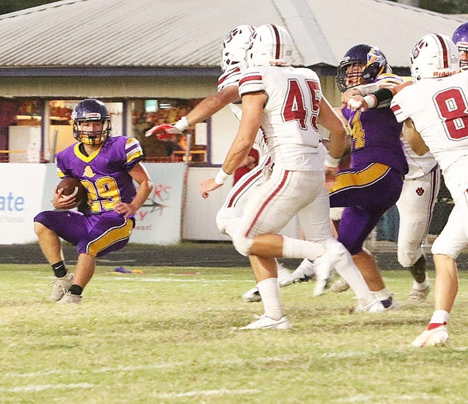 Ethan Jurquet (19) ran for 90 yards and a touchdown in helping lead the South Beauregard Golden Knights to a 22-7 non-district win over Vinton on Friday.