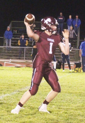 Swink High School's Hunter Bauserman looks for an open receiver in the Lions' 12-6 loss to Calhan on Oct. 1 at Gene Brown Field.