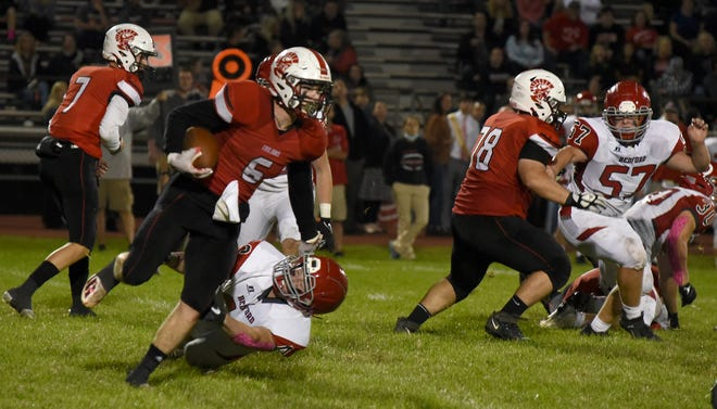 Carson Deseranno of Monroe breaks the tackle of Gabe Johnson of Bedford for a gain Friday, October 1, 2021.