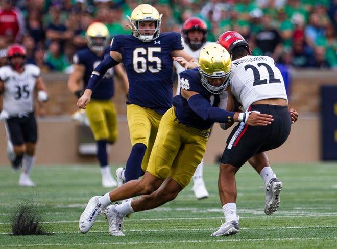 Notre Dame's Kyle Hamilton (14) tackles Cincinnati's Ryan Montgomery (22) during the Notre Dame vs. Cincinnati NCAA football game Saturday, Oct. 2, 2021 at Notre Dame Stadium in South Bend.