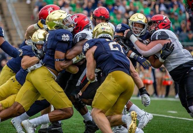 Cincinnati's offense crashes against Notre Dame's defense during the Notre Dame vs. Cincinnati NCAA football game Saturday, Oct. 2, 2021, at Notre Dame Stadium in South Bend.