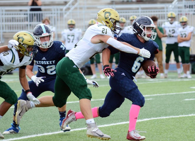 Petoskey's Rippin Vining breaks into the second level as West's Michael Schermerhorn comes in to make a stop Saturday at Northmen Stadium.
