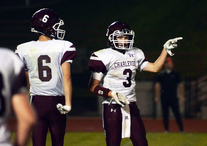 Charlevoix's Patrick Sterrett (3) shows the crowd which way it's going now after his interception gave the Rayders the ball back for victory formation.
