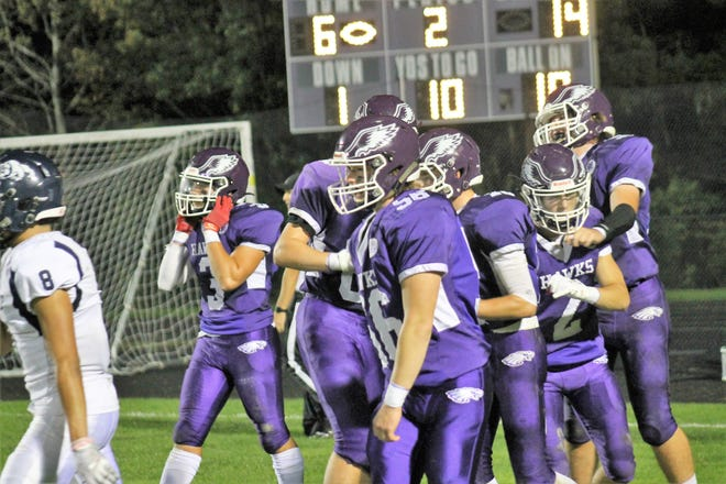 Ryan Tarr (3), Will Anderson (56) and Cam Cornett (2) are among the players celebrating Marshwood's first touchdown late in the first half of Friday night's Class B South game against Portland.