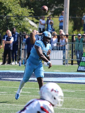 URI quarterback Kasim Hill throws a pass against Stony Brook on Saturday at Meade Stadium. Rhody won, 27-20, in OT and is now 4-0 on the season.