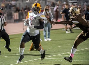 Edison's Jaylen Blacksher gets by Stagg's Kamario Thomas-Gray during a varsity football game at Stagg in Stockton.