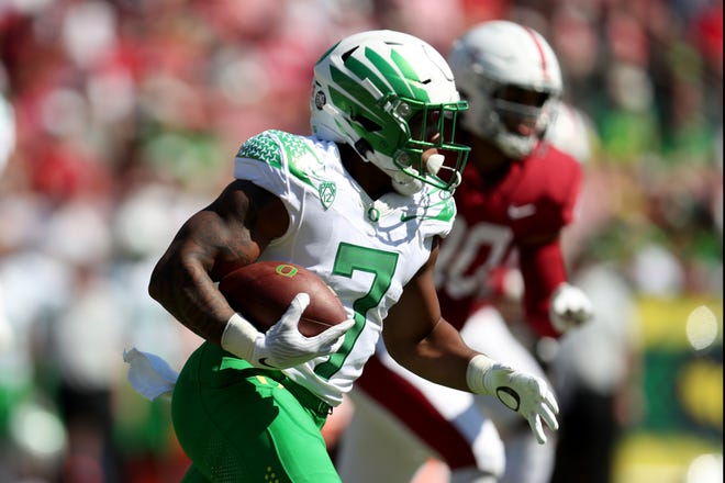 Oregon's CJ Verdell runs against Stanford during the first quarter of Saturday's game at Stanford Stadium.