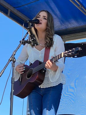"""Stark County native Lauren Mascitti gave a rare hometown concert on Friday afternoon at Hartville MarketPlace & Flea Market. Mascitti works as a nurse in Tennessee and continues to record music. Mascitti is a former """"American Idol"""" contender."""