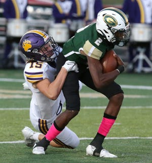 Isaiah Knox, 2, of GlenOak is sacked by Ethan Lesco, 15, of Jackson during their game at GlenOak on Friday, Oct. 1, 2021.