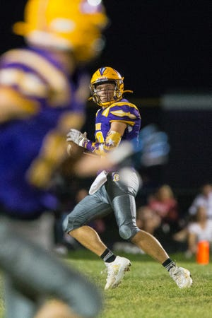 Hononegah quarterback Isaac Whisenand looks for a throw against Belvidere North in the fourth quarter of their game on Friday, Oct. 1, 2021, at Hononegah High School in Rockton. Hononegah beat Belvidere North, 14-9.