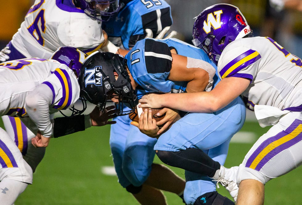 North Mac's Kaden Brown (17) takes a head on hit from Williamsville's Joshua Cates (25) as he is brought down on a rush in the second half at North Mac High School in Virden, Ill., Friday, October 1, 2021. [Justin L. Fowler/The State Journal-Register]
