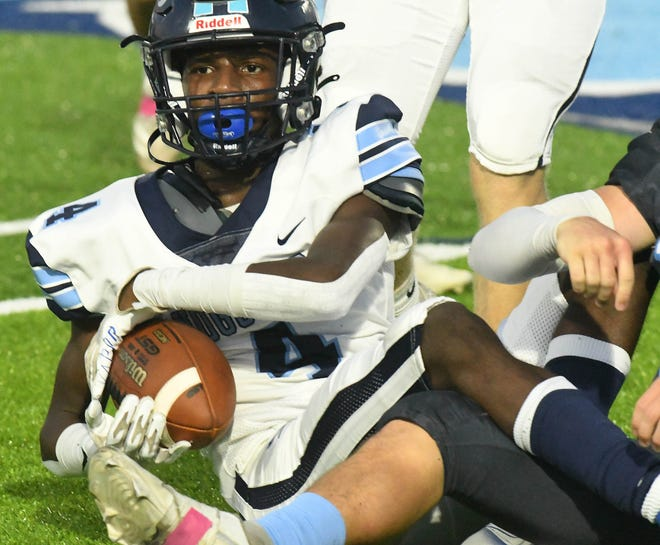 Hoggard's #4 Brian Valladares comes up with a fumble as South Brunswick took on Hoggard at home Friday Oct. 1, 2021. Hoggard shutout South Brunswick 31-0.  [KEN BLEVINS/STARNEWS]