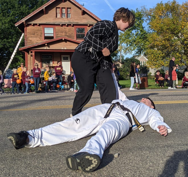 Members of Strongheart Martial Arts during the Northern State University homecoming parade Saturday on Main Street.