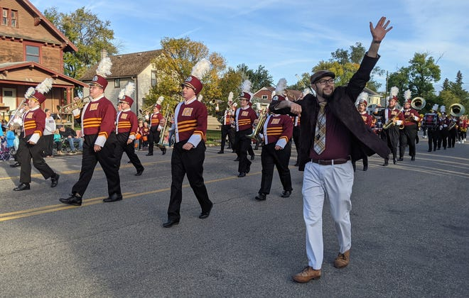 Travis Netzer, lecturer of euphonium and tuba at Northern State University, greets the crowd at the onset of Saturday's Gypsy Day Parade on Main Street.