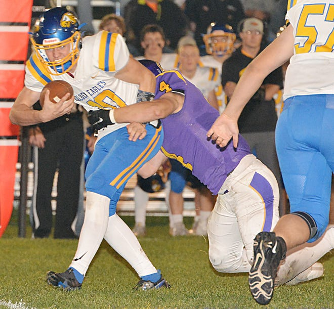 Aberdeen Central quarterback Sam Rohlfs is brought down by Watertown's Hunter Wientjes. Public Opinion photo.