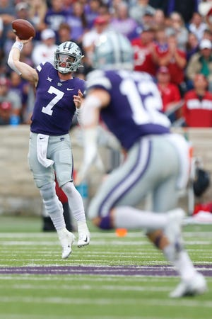 Kansas State senior quarterback Skylar Thompson (7) throws a pass to senior wide receiver Landry Weber (12) in the second half of Saturday's game against Oklahoma at Bill Snyder Family Stadium.