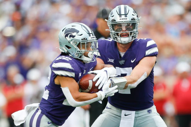 Kansas State  quarterback Skylar Thompson (7) hands off to running back Deuce Vaughn (22) during last Saturday's game against Oklahoma at Bill Snyder Family Stadium. The Wildcats are off this week before playing host to Iowa State on Oct. 16.