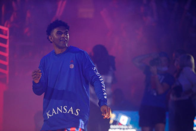 Kansas super senior guard Remy Martin enters the court at Allen Fieldhouse during Late Night in the Phog.