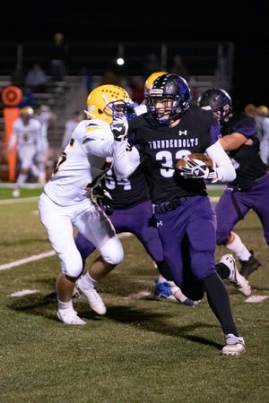 Rye High School's Dylan Hurne gains positive yards on a run during the matchup with Florence High School on Friday, Oct. 1, 2021.