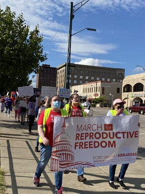 Approximately 100 people march for their reproductive rights Saturday.