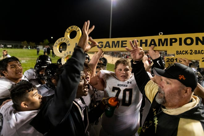 The Hesperia football team celebrates after a last-minute comeback sealed the deal against  Sultana in the Key Game on Oct. 1, 2021, at Jay Reed Field. The Scorpions won 28-27 after a touchdown with less than 10 seconds left in the game.