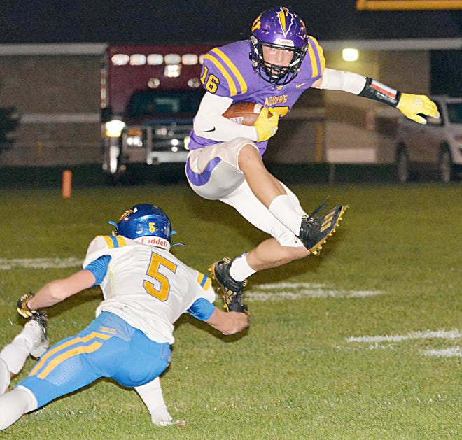 Watertown's Collin Dingsor leaps over Aberdeen Central's Cole Artz after making a reception during the Arrows' homecoming football game Friday night at Watertown Stadium. Dingsor ran to the 1-yard line to set up the Arrows' first score in a 30-0 win.