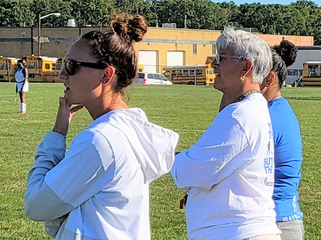 Salem assistant coach Shanna Scott, head coach Donna O'Leary and assistant Kayla Chapman watch the Rams play against Deptford.