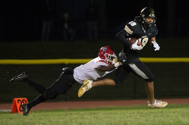 Burlington Township's AJ Johnson catches a pass and runs the ball in for a 79-yard touchdown as Pennsauken's Premier Wynn attempts to make the stop during the 1st quarter of the football game played at Burlington Township High School on Friday, October 1, 2021.