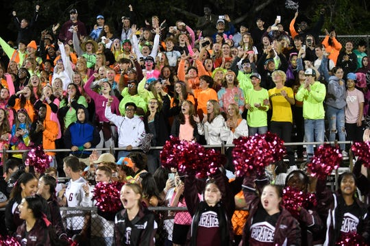 Cedar Creek football fans cheer for the Pirates following a 7-6 win over Holy Spirit on Friday night in Absecon, N.J. Oct. 12, 2021.