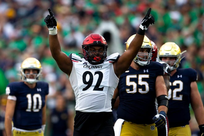 Cincinnati Bearcats defensive lineman Curtis Brooks (92) celebrates after a 4th down stop in the fourth quarter of the NCAA football game on Saturday, Oct. 2, 2021, at Notre Dame Stadium in South Bend, Ind. Cincinnati Bearcats defeated Notre Dame Fighting Irish 24-13.