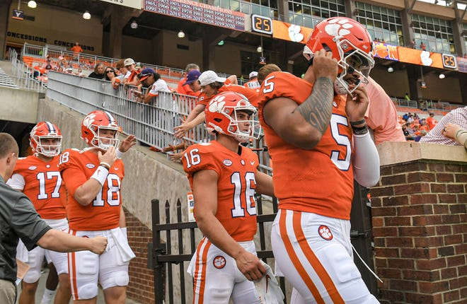 Clemson's Will Taylor (16) and D.J. Uiagalelei take the field for warm-ups prior to Clemson's game vs. Boston College Saturday night at Memorial Stadium.