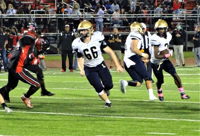 Lancaster's Jacob Rohr leads the way as running back Nasir Robinson looks for running room during the Golden Gales' 30-14 Ohio Capital Conference-Buckeye Division win over the Cruisers.